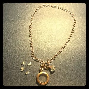 An origami owl necklace plus charms